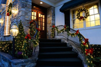how to hang christmas lights outside around door windows home guides sf gate. Black Bedroom Furniture Sets. Home Design Ideas