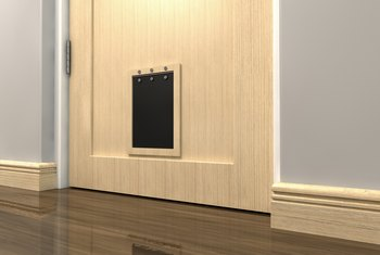 How to install a pet door on an existing steel door home - Interior door with pet door installed ...