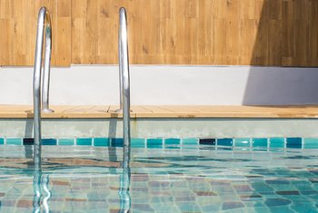 How to Remove Hard Water Stains From Pool Tiles