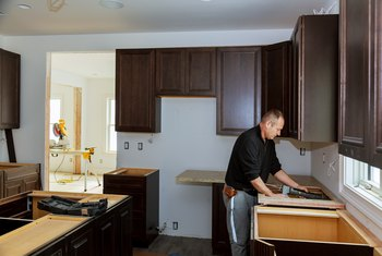 How to Remove Laminate Countertops From Particle Board Countertops