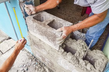 How to Fill Holes in a Cinder Block Wall