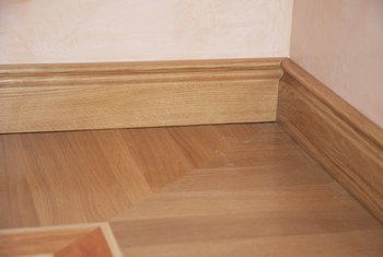 How to Cut 45 Degree Angle Baseboards With a Hand Saw