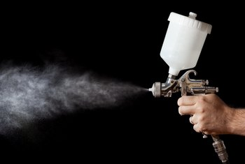 How to Paint With a Spray Gun for the Interior of Homes