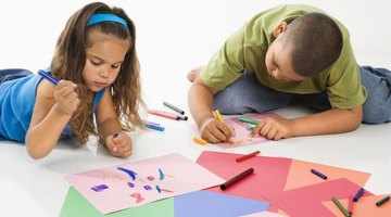 Use construction paper, glue and crayons to create easy glyphs.