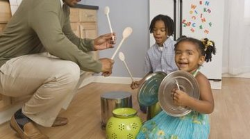 Young children can explore music with common household objects.