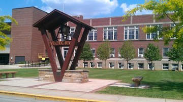 The Victory Bell, rung after athletic victories and campus celebrations, stands near the Athletics and Recreation Center.