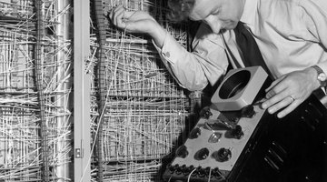 Man working on early electronic computer