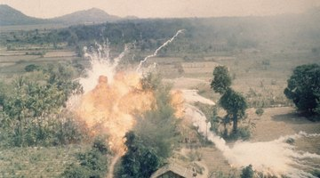 A napalm bomb explodes during a strike south of Saigon during the Vietnam War