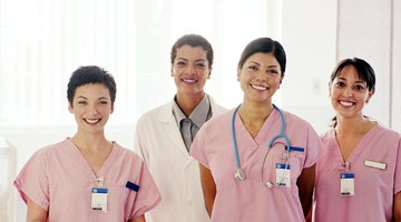 Smiling nurses standing in front of doctor