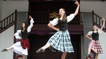 Highland dancers compete at a festival