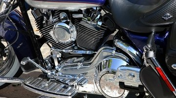 Reflection of motorcyclist in side mirror