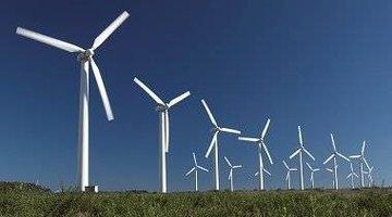 row of wind turbines in a field