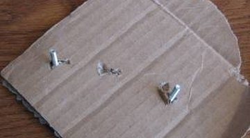 Attach the hardware and screws to cardboard.