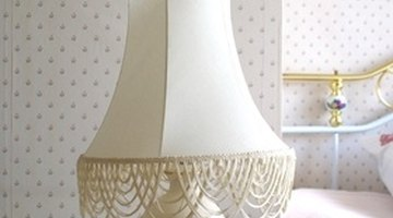 If it's a guest bedroom, consider putting a pretty table lamp beside the bed.