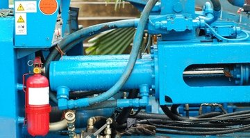 A hydraulic ram is used in conjuction with a hydraulic pump to shape and mold metal.