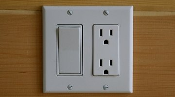 Remove switch plates by removing screws with a screwdriver.