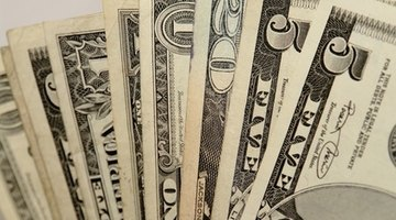 Money contains fluorescent strips that prevent counterfeiting.