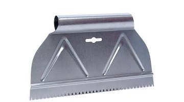 A metal scraper helps lift stuck-on adhesive.