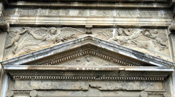 A pediment adorns a building's main entry.