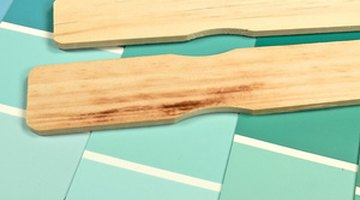 Mix your fiberglass cleansing solution with a paint stirrer.