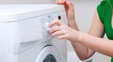 Woman setting front loading washing machine