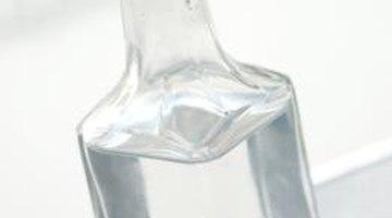 Vinegar breaks down sticky residue on glasses.