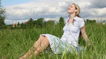 Pregnant woman taking pill against heartburn