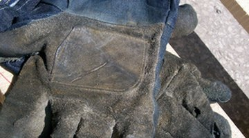Work gloves protect your hands from splinters when you're fitting wood kitchen components.
