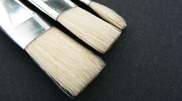 A hard-bristled brush helps dissolve the charcoal chunks.