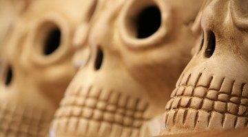 Hand-carved skulls line streets and altars during the Dia de Los Muertos celebration.