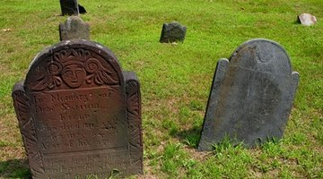 Find the burial marker of the first grave.