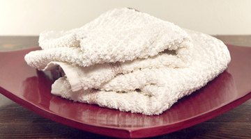Using white towels for stain removal allows you to see how much stain you've lifted.