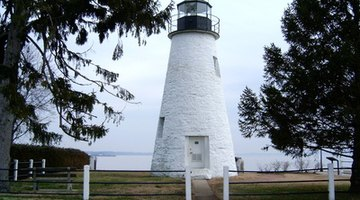 The wood doughnuts help keep a cone-shaped lighthouse sturdy.