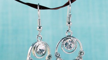 Earrings adorned with iolite are an appropriate gift idea for a 21st anniversary.