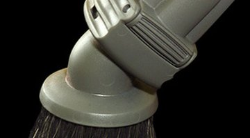 Using an attachment with a brush can help roust out any dirt beneath the surface.
