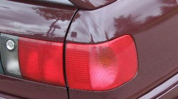 Headlight on new car in showroom