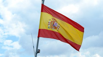 The Spanish flag is defined by red and yellow bands and a crest.