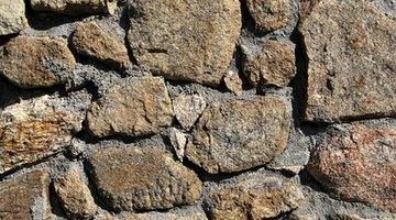Acid is able to penetrate and clean stone and cement.