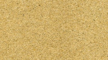 Sandpaper's abrasiveness smooths your stained oak floor surface.