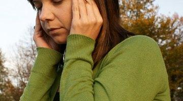 ¿Cuáles son las causas de las luces centelleantes en los ojos seguidas de dolor de cabeza?
