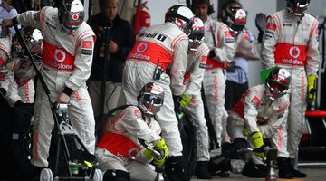 Mechanics work in the pit crews during races.