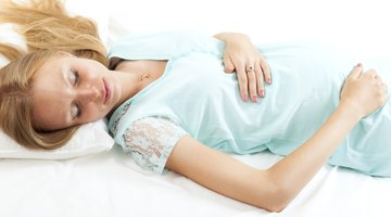 Pregant Woman Lying on Bed