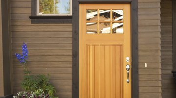 A rustic wood front door on a modern home.
