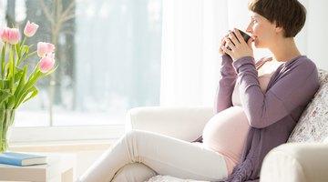 Pregnant woman with prenatal vitamins