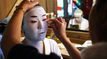 All kabuki make-up begins with a thick layer of white.