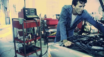 Auto mechanic fixing vehicle