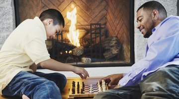 Father and son playing in front of fire