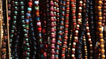 Make colourful beaded necklaces.