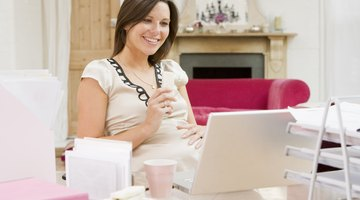 Midsection Of Pregnant Woman Holding Milk Glass