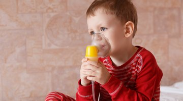 Fever, measuring temperature for little boy